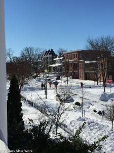 Snowzilla Day 3 - A view of people walking in the middle of the street from the balcony